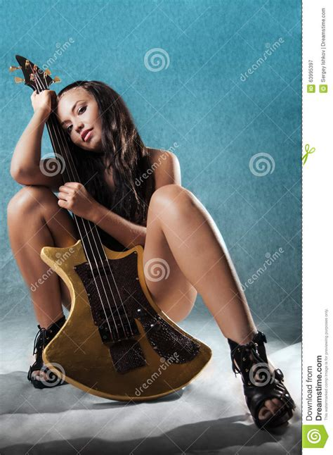Woman with guitar stock image